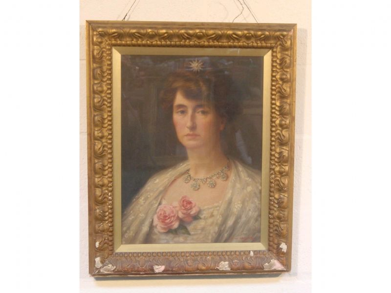 Head and shoulders portrait of an Edwardian lady wearing a white lace gown, roses and diamonds