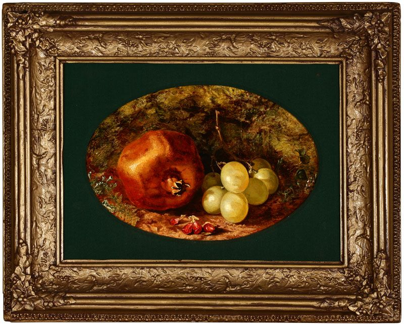 Still life with pomegranate and grapes in a naturalistic setting