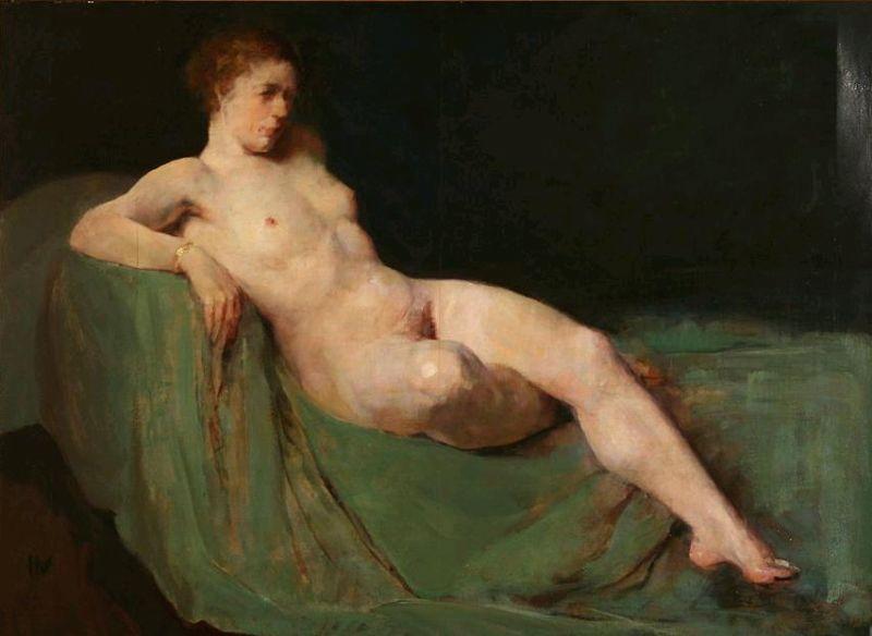 A nude female on a sofa