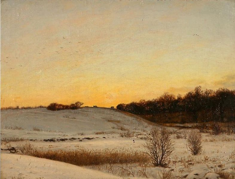 Winter landscape with snow covered fields at sunset