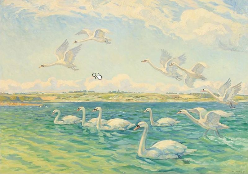 A flock of swans at a larger lake