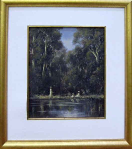 Figures by a lake